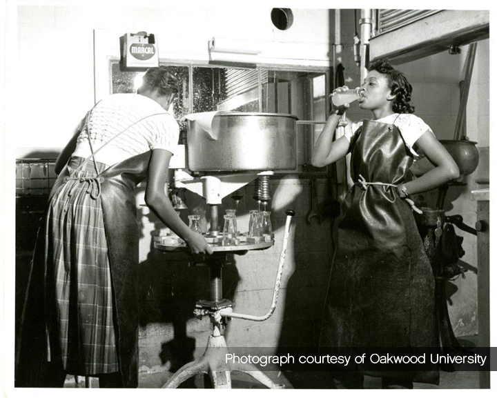 Student workers in the Oakwood dairy where milk and juice were bottled. No Date.